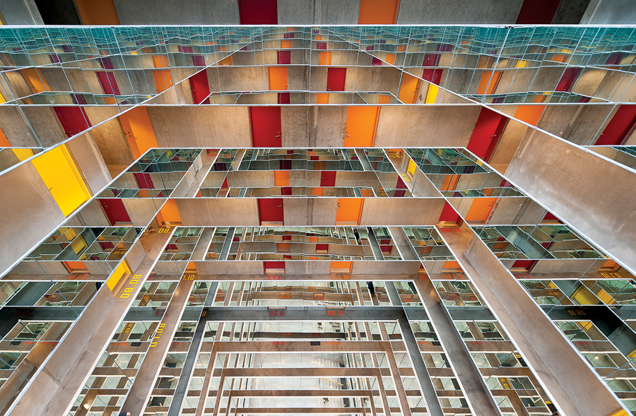 In the Danish university city of Aarhus, the Grundfos Dormitory by CEBRA encases a 12-storey atrium with mirror-clad balconies, creating drama with an economy of means. Mikkel Frost