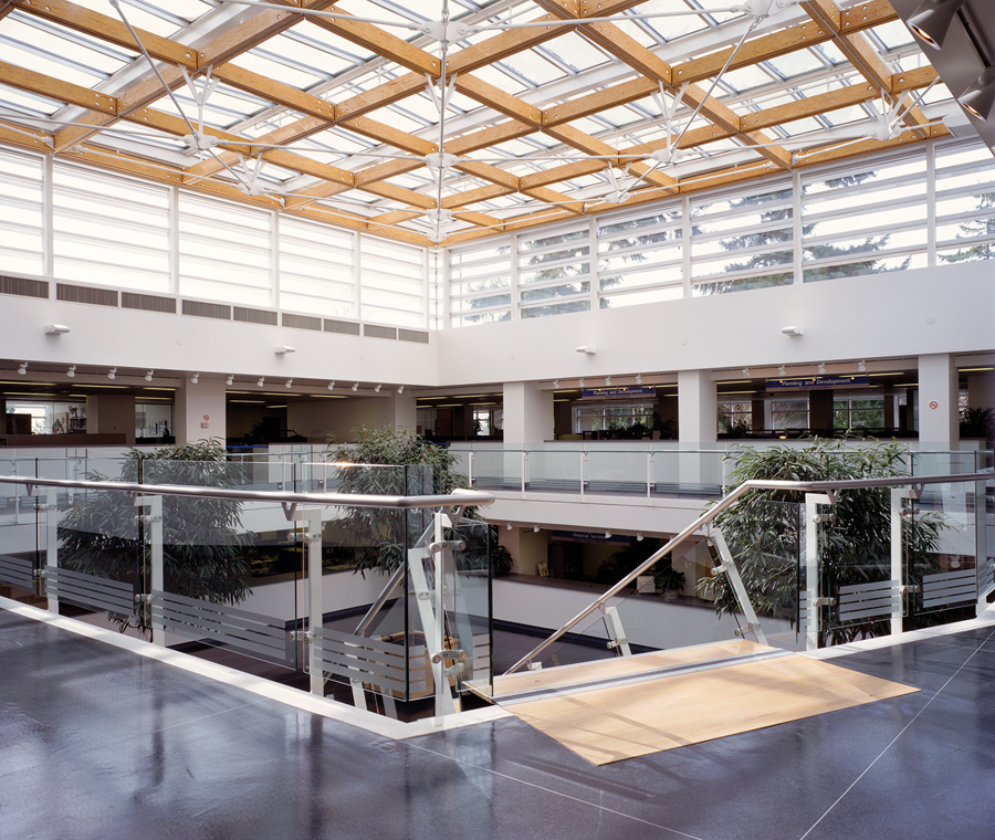 Completed with Frits de Vries Architect in 1995, the renovation and expansion of the District of North Vancouver Municipal Hall reoriented the facility around a three-storey atrium. Martin Tessler