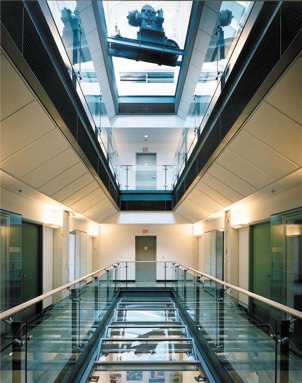 In 1998, Busby + Associates Architects with Robert Lemon Architecture & Preservation retrofitted a downtown newspaper printing press building into the AIBC's headquarters. The architects added a central atrium to provide natural light and ventilation to all three office levels.