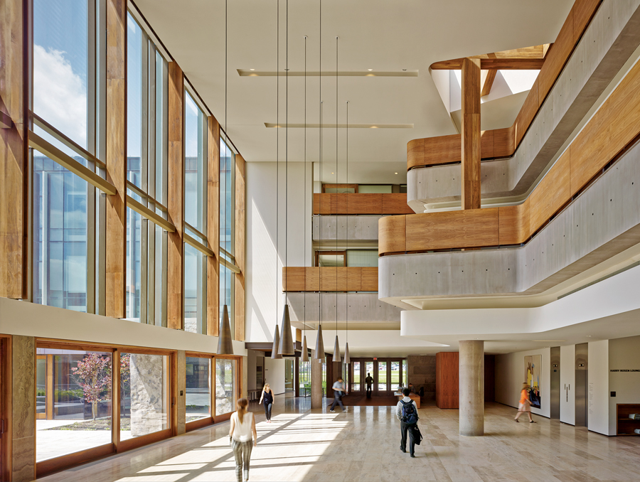 A view of the main lobby, which opens up to the courtyard in fair-weather months. Nikolas Koenig