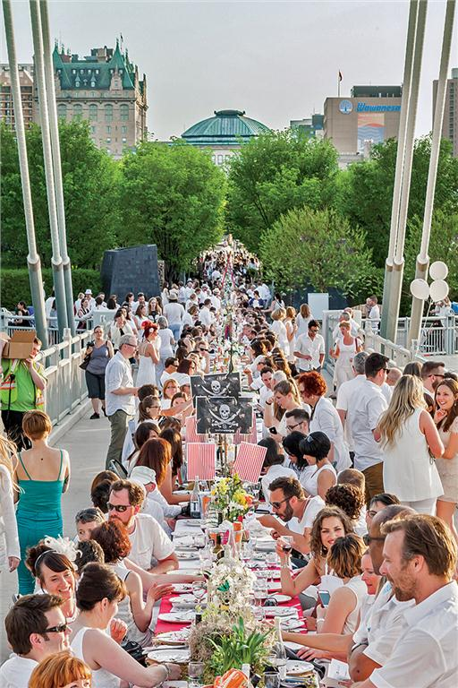 1,200 guests dressed in white met for an outdoor dinner in winnipeg on may 31, 2015
