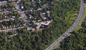 The building's sinuous form cradles the central chapel and hugs the edge of the Don Valley ravine, affording expansive views to the Sisters who live within it.