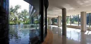 Opposite the main entrance, a reflecting pool surrounds the jewel-like chapel.
