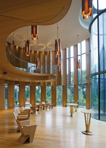 The chapel draws from the tectonic language of Shim-Sutcliffe's Integral House, employing full-height vertical white oak louvres and suspended light fittings.