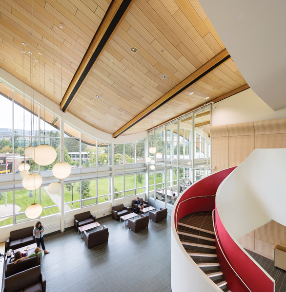 A glazed interior wall enables sight lines between the lobby and library reading room, while a dramatic staircase accesses the upper floor.