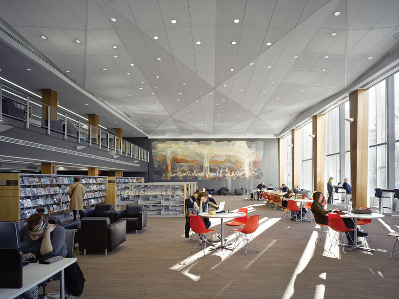 Book stacks were cleared from a space near the front of the building, creating a grand reading room embellished with a mural by Jack Bechtel dating from the 1960s.