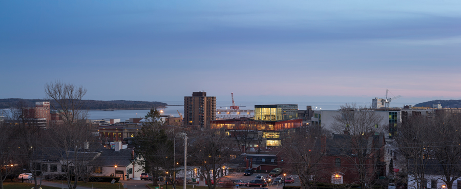 The new library is a colourful stack of glass boxes, located on a prominent site in Halifax's compact downtown core. On the top level, a reading room and terrace look out towards the historic Halifax Citadel and the city's harbour, which includes an active port and shipyard.