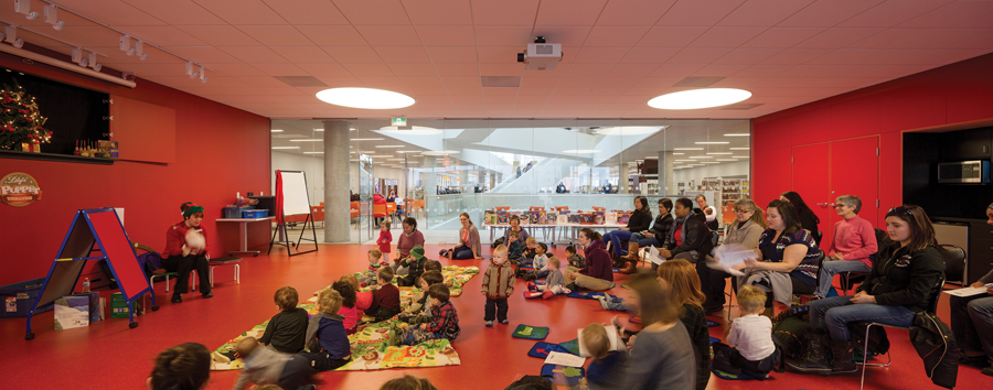 Toddlers enjoy story time in one of several program rooms.