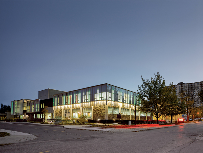 A rhythmic use of curtain wall ties together the existing building and new addition.