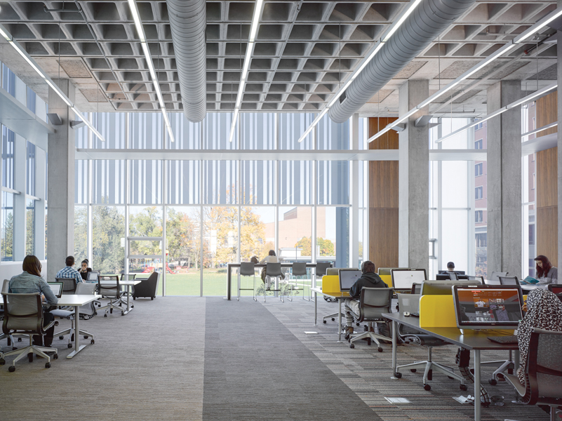 A waffle-slab ceiling tops a new reading room.