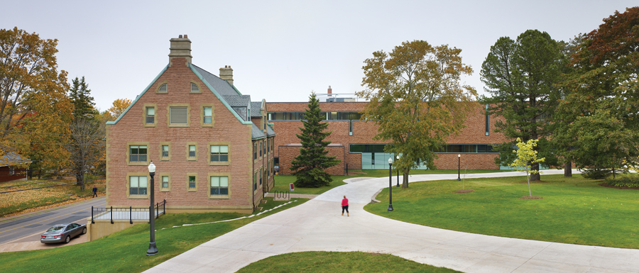 The choice of red sandstone cladding ties the Purdy Crawford Centre to other campus structures, including the adjacent Bennett Building.