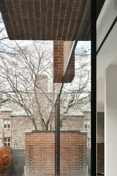A minimal soffit detail connects the old and new portions of the house.