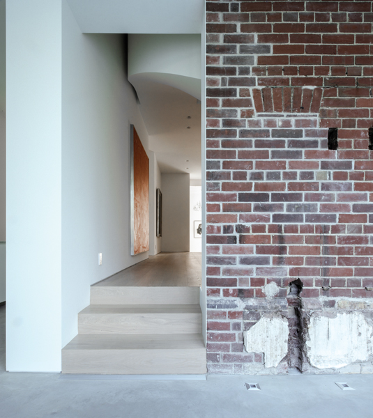 The renovation retains the patina of the existing brick walls.
