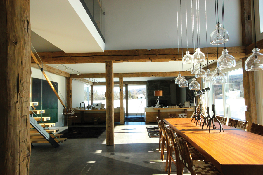 The interior features a post-and-beam structure made from reclaimed timbers.