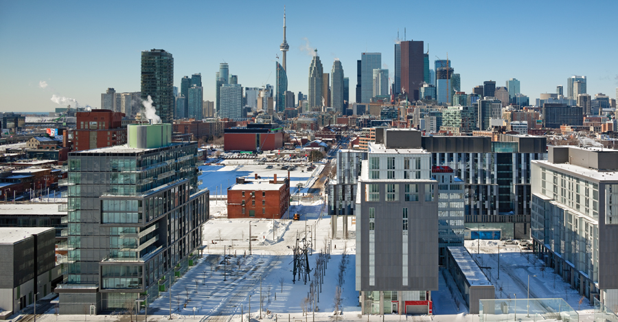 Toronto's Front Street culminates in the new Canary District, a mixed-use development including retail spaces, market condominiums, affordable housing, a student residence and a community YMCA. Photo by Tom Arban.