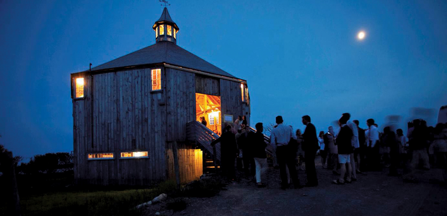 The Troop Barn was one of two remaining octagonal barns in Nova Scotia when it was deregistered as a heritage building in 2008. and for Ghost 11, a team led by Brian MacKay-Lyons and Robert Cram disassembled, transported and reconstructed the barn in Upper Kingsburg. Photo by Stephanie Mackinnon