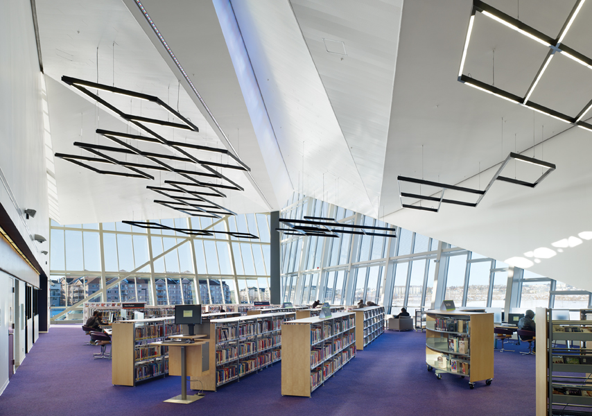 The library occupies the prow of the building, and is distinguished by its folded ceiling plane. Photo by Tom Arban