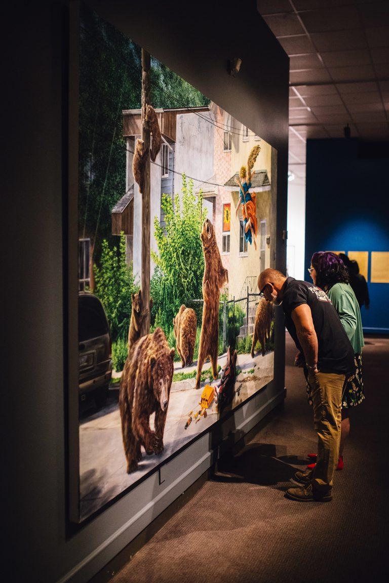 Man and woman look at art