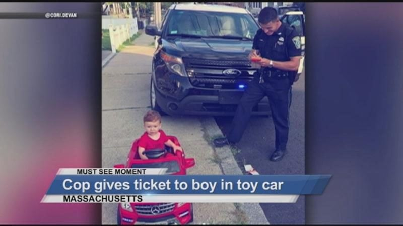 MUST SEE : Cop gives ticket to boy in toy car