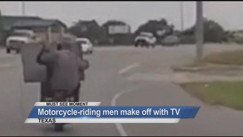 MUST SEE: Motorcycle-riding men make off with TV