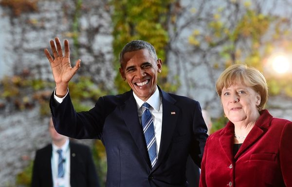 648x415_topshot-us-president-barack-obama-is-greeted-by-german-chancellor-angela-merkel-upon-arrival-at-the