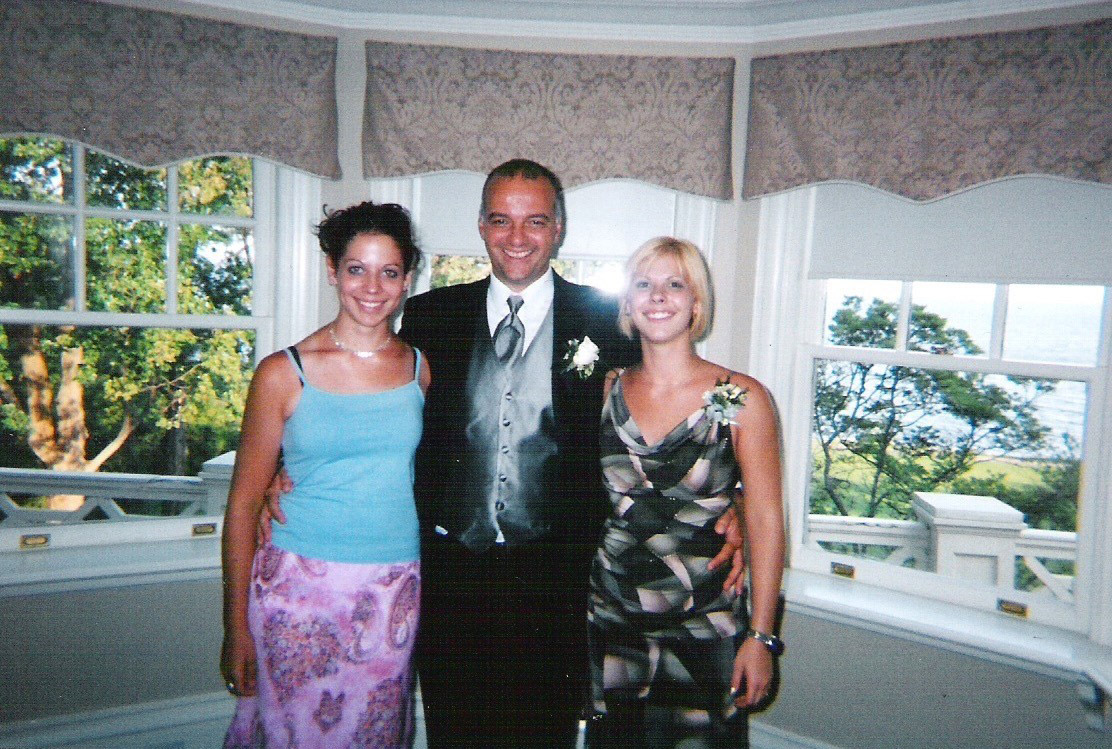 Stephanie is pictured with her uncle Frank, smiling in front of a window