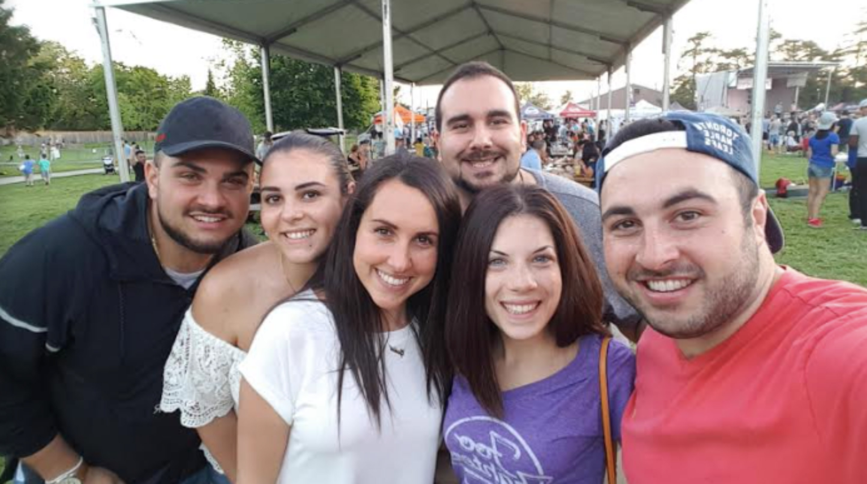 Giulia and friends smiling at an event.