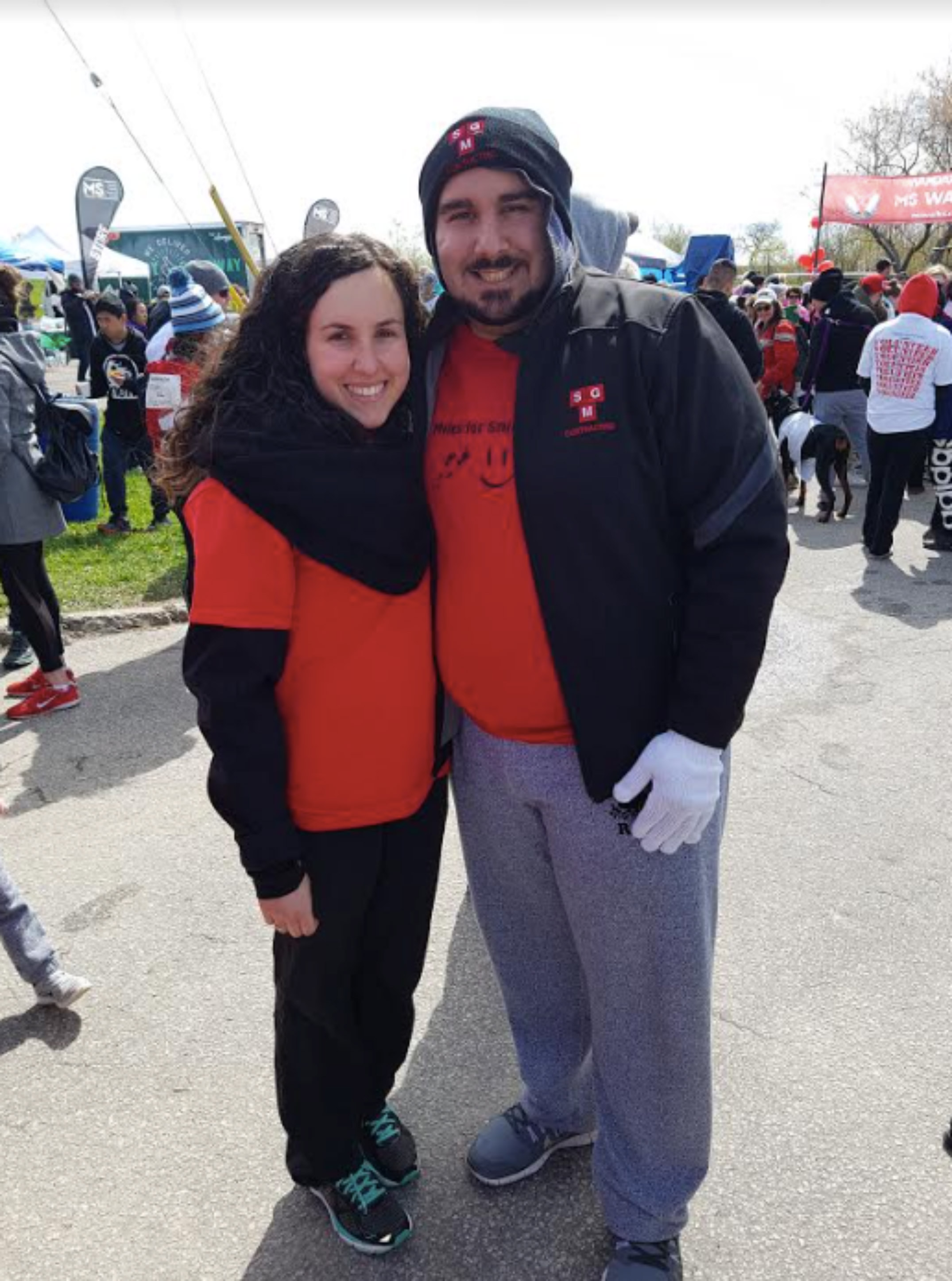 Giulia and man standing at MS Walk event.