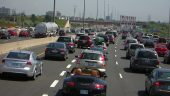 Congestion on Highway 401 contributes to Ontario's greenhouse gas emissions. Photo by Robert Jack via Flickr Commons.