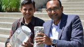 UBC's Anant Parghi (left) and Assoc. Prof. Shahria Alam hold up a piece of 'green' concrete and some of the glass that helped make it. Photo courtesy of UBC.