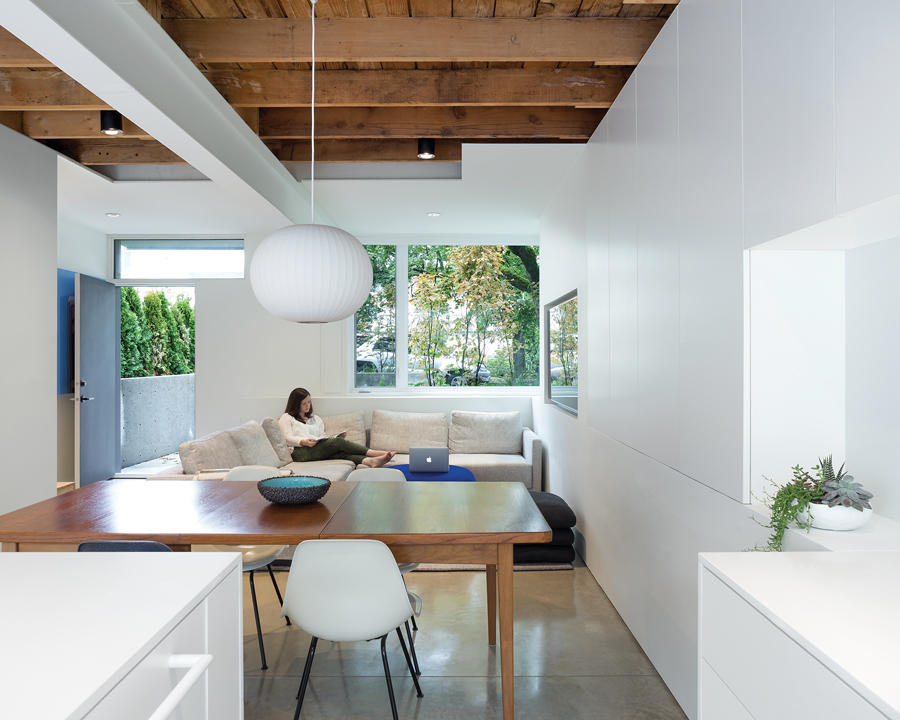Where possible, the architects preserved existing elements of the house.  The original wooden joists were left exposed, contrasting with the sleek white of the renovation.