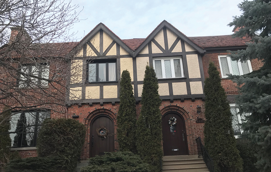 As seen from the street: the rowhouse's original Tudor-style front facade