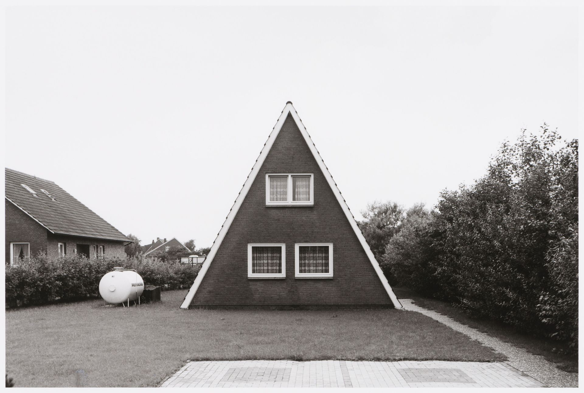 Wilhelm Schürmann, photographer, Brick A-frame house, with gas ...