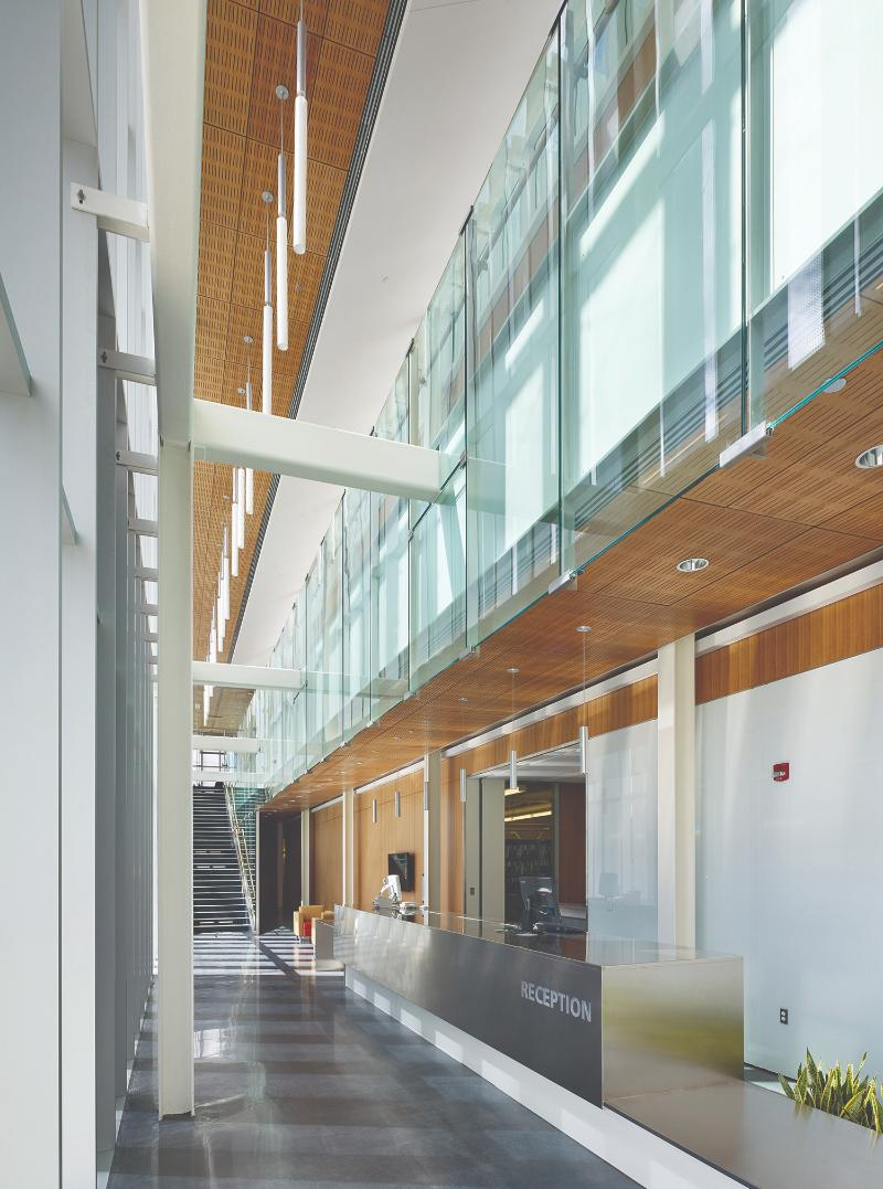 The reception foyer, elegantly designed and filled with natural light, exemplies the architecture's attention to visitor and employee well being, advancing the industrial-building typology.