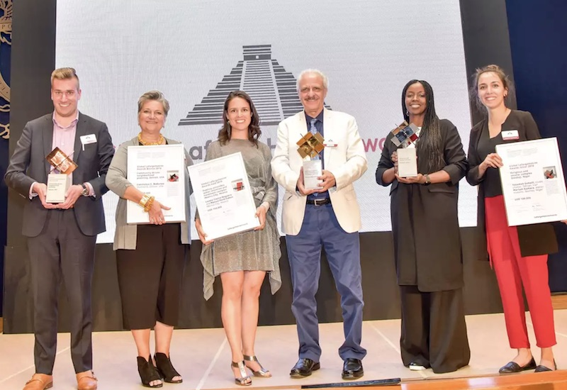 Global LafargeHolcim Awards 2018 winners (l-r): Bronze – Eric Mahoney and Constance Bodurow, studio[Ci], USA; Gold – Loreta Castro, Taller Capital and Manuel Perló, Universidad Nacional Autónoma de México (UNAM), Mexico; and Silver – Mariam Kamara, Atelier Masomi, Niger and Yasaman Esmaili, Studio Chahar, Iran.