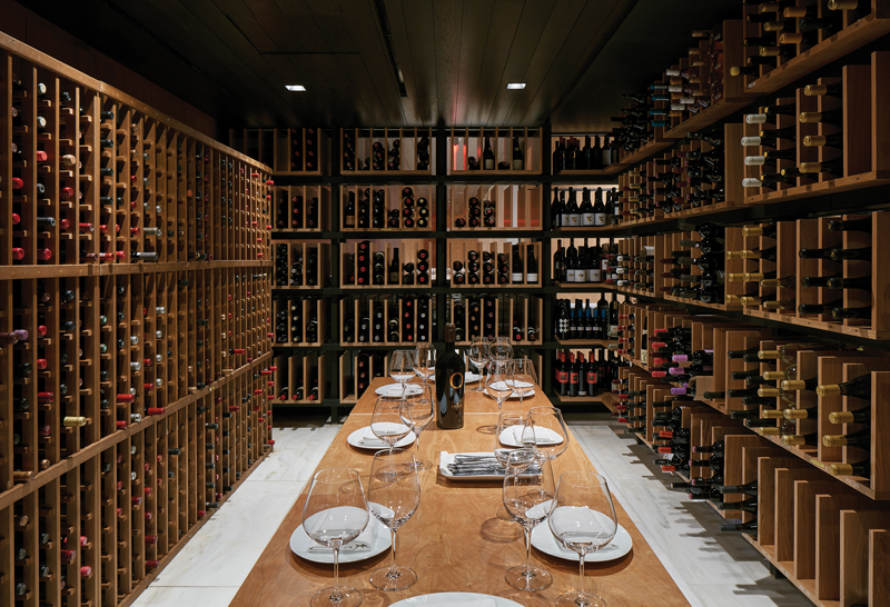 Floor-to-ceiling wine racks double as dining room walls.