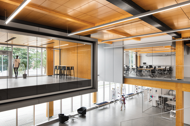 The atrium includes views to a student lounge and studios on the second level.