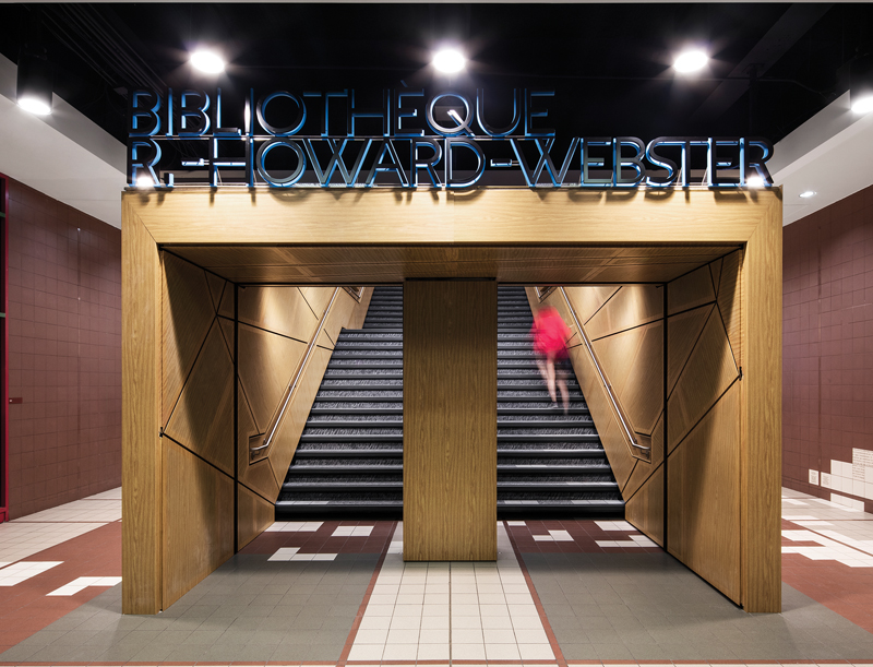 A  wood-framed  portal  on  the  ground  level  of  the  existing  building  invites  students  to  the  renovated  library.  ABOVE  Fuschia-hued  carpet  inserts  and  millwork  add  visual  punch  to  the  second-floor  reference  desk  area.