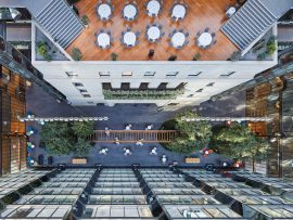 A soaring atrium connects Erickson's two towers to the original neoclassical bank building. Perkins+WillÕs renovation creates collaborative work areas throughout the complex, including on the rooftop of the 1938 structure.