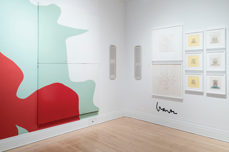 A selection of Michael GravesÕ hand drawings is accompanied by an oversized signature on the wall. Graves often used tracing paper  to expediently copy his own work, in order to satisy the enormous market demand for his personal drawings