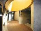 An elliptical skylight brings daylight deep into the building interior