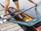 The rower steps down into the boat, onto the footwell