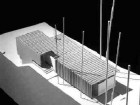A model view showing the zinc roof folding over the north elevation.