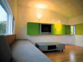 Four views of DIN's Z House, Gimli, Manitoba. Millwork and furniture items provide intense colour accents within the house's otherwise spare vocabulary.