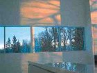 Four views of Sotirios Kotoulas' Stone House, north of Winnipeg. The minimally-coloured house reflects colours from the surrounding landscape.