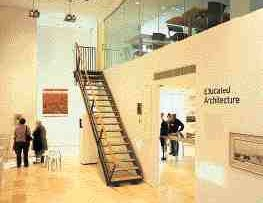 A stair helps complete the sinuous spatial circuit between the library and gallery.
