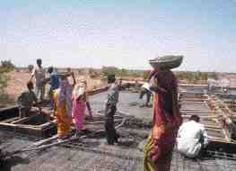 Casting the roof slab on a Primary Health Centre in earthquake-stricken Gujarat State, India.
