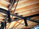 Delicate king post trusses support wood joists.