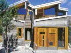 Doors and windows are constructed of cedar recycled from telephone poles