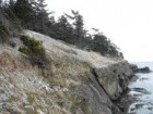 The site encompasses a steep drop to the edge of the water.